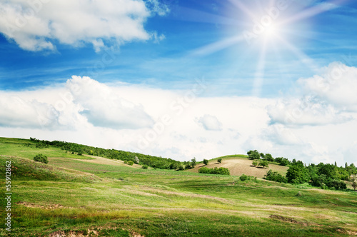 Spoed Foto op Canvas Blauw Mountainous terrain and the blue sky