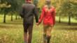 Caucasian couple walking hand in hand