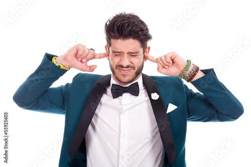 Young business man keeping his ears shut Wallpaper Mural
