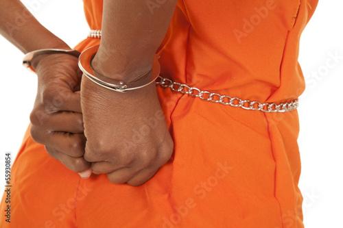 Fotografia, Obraz  woman prisoner orange hancuffs up close