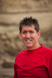 Smiling man at sand cliffs
