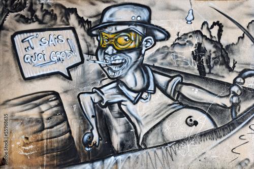 graffiti-czlowieka-w-samochodzie-wewnatrz-opuszczonej-fabryki