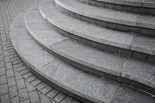 Curved Modern Gray Stone Stair...
