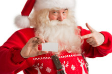 Portrait Of Happy Santa Claus Showing Blank Business Card