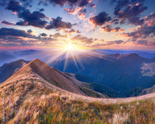 Foto op Aluminium Zalm Colorful autumn landscape in the mountains. Sunrise