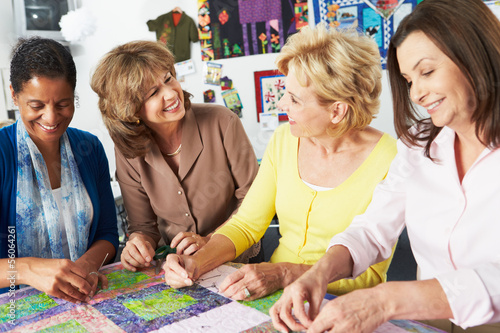 Photo  Group Of Women Making Quilt Together