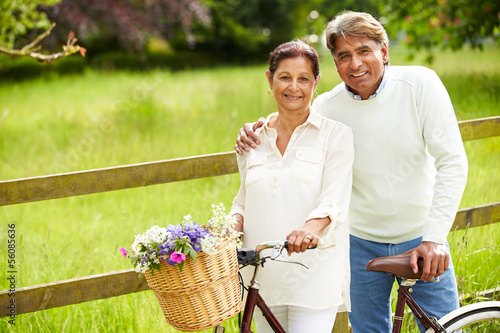 Fototapeta Senior Indian Couple On Cycle Ride In Countryside