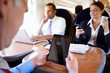 Business people On Train Using Digital Devices