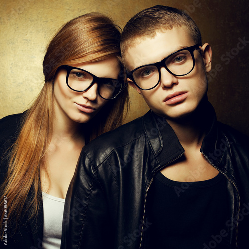 Photo  Portrait of gorgeous red-haired fashion twins in trendy glasses