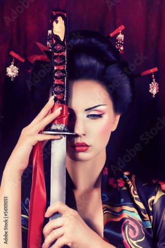 Fotografie, Tablou  Beautiful geisha in kimono with samurai sword