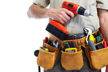 Handyman With A Tool Belt And Drill.
