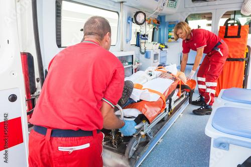 Fotografie, Obraz Rescue Team Providing First Aid