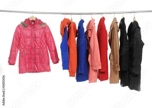 Fotografie, Tablou  Set of colorful jacket, coat hanging on hanger