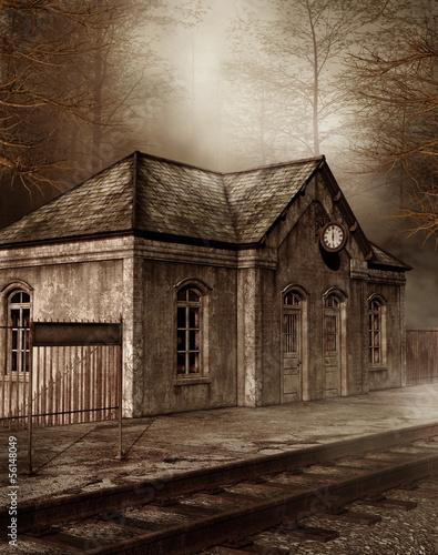 Obrazy na płótnie Canvas Stara stacja kolejowa w lesie
