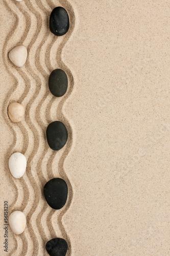 Tuinposter Stenen in het Zand Black and white stones lie on the sand