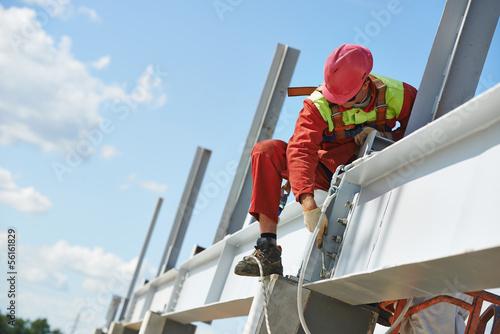 Fotografie, Obraz  builder millwright worker at construction site