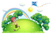 A Boy Playing With His Kite At...