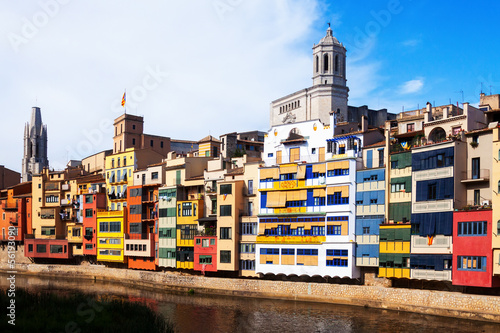 Day view of houses on the river bank in Girona