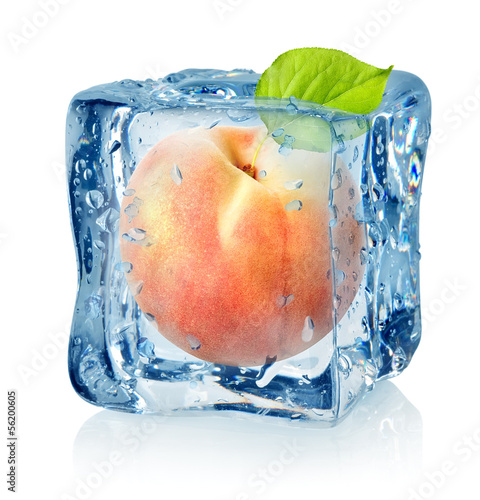 Staande foto In het ijs Ice cube and peach isolated