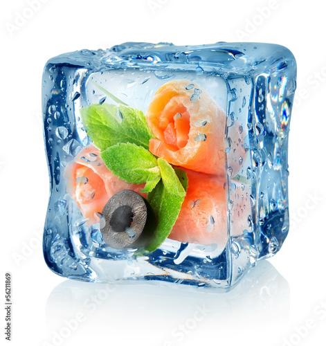 Staande foto In het ijs Fish rolls in ice cube