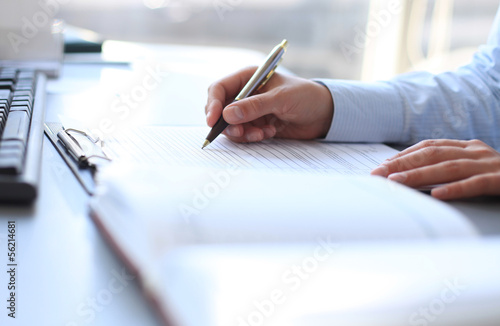 Photo  Businesswoman hands pointing at business document