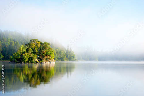 Photo sur Aluminium Bleu clair Island on foggy morning