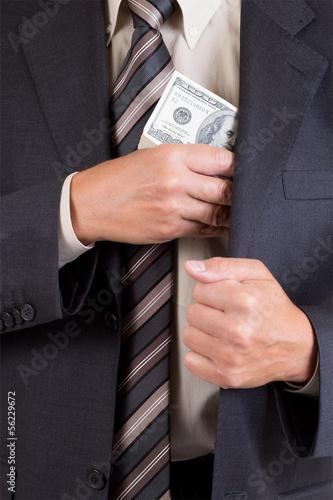 Canvas-taulu man putting dollars pack into pocket