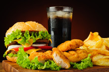 Burger, Chicken Nuggets, French Fries And Cola Drink