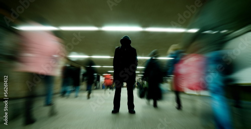 Fotografía  Black silhouette standing in crowd