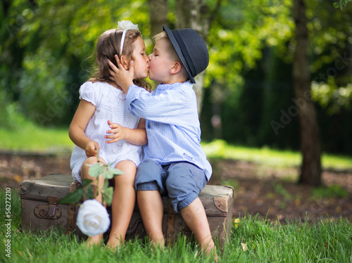 Valokuva Cute couple of children kissing each other