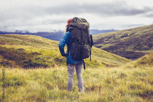 Hillwalker standing in the middle of mountain wilderness
