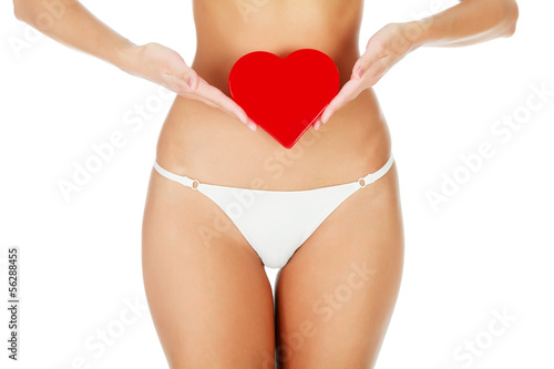 Fotografie, Obraz  Woman with a red heart, white background