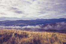 Mist Rolling Across Mountain Landscape