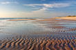 Sandwatt mit Rippelmarken im Abendlicht am Weststrand von Sylt
