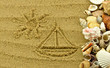 Rysunek na piasku z muszlami
