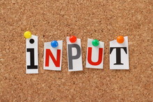 The Word Input On A Cork Notic...