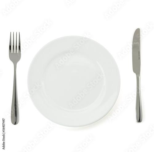 Spoed Foto op Canvas Klaar gerecht plate, knife and fork on white