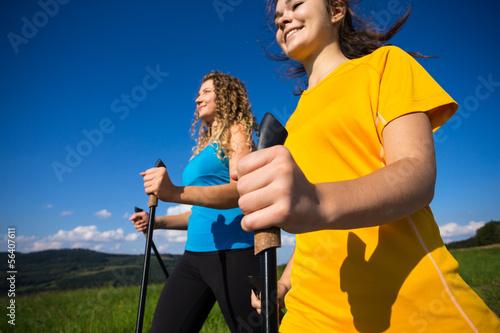 Nordic walking - active people outdoor (focus on hand)