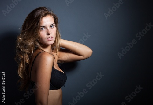a225b8ba808 Portrait of sexy woman in lingerie on dark background - Buy this ...