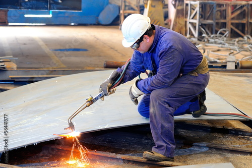 Canvas a welder working at shipyard in day time