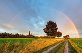 Fototapeta Tęcza - Rainbow over field road
