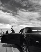 Woman Entering Luxurious Car