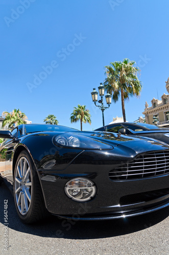 Photo  Expensive sports car in Monaco with palm trees and blue sky