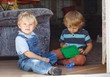 Two adorable little brother boy playing together indoor