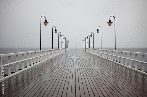 old pier in rain on Baltic sea Orlowo Gdynia Poland #56495892