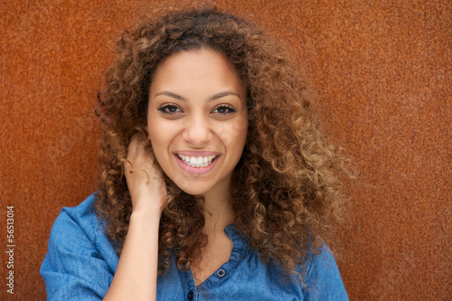 Fototapety, obrazy: Attractive young woman smiling with hand in hair