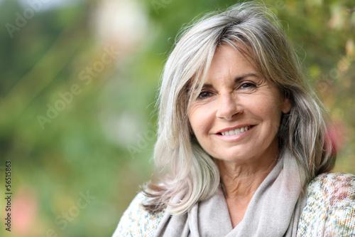 Fototapeta Portrait of serene mature woman in garden obraz
