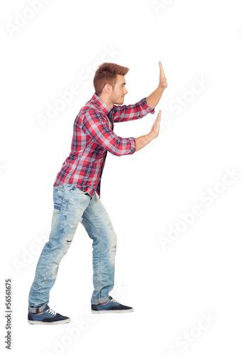 Cuadros en Lienzo Young man with plaid shirt pushing