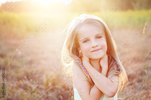 Happy little girl on summer meadow Canvas-taulu