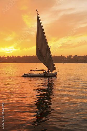 Fotografija Felucca boat sailing on the Nile river at sunset, Luxor